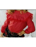 Blouse and bloomers with ruffles.