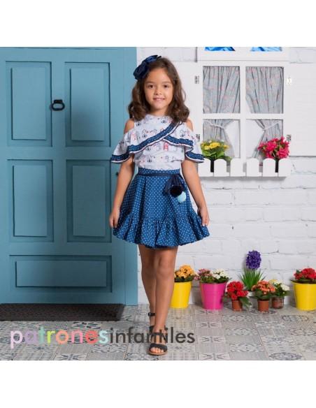 Conjunto de blusa y falda de capa