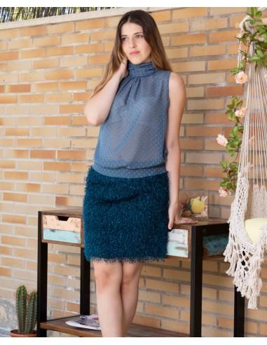 Conjunto de blusa y falda.